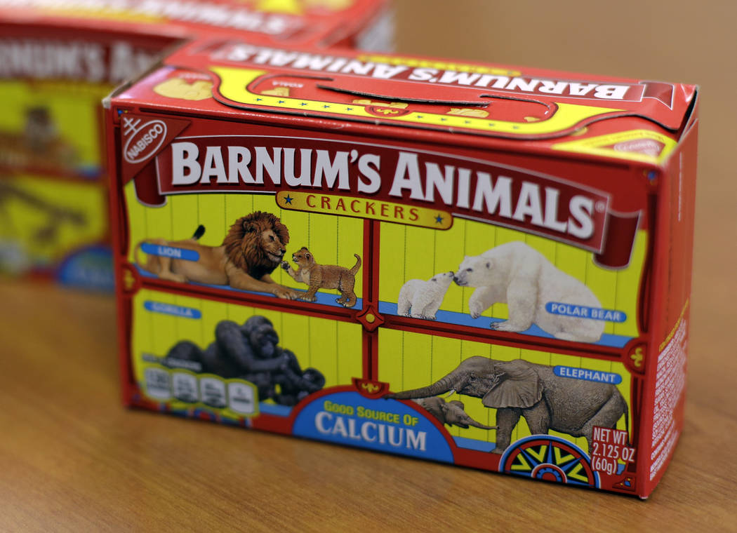 This Monday, Aug. 20, 2018, photo shows boxes of Nabisco's Barnum's Animals crackers in Chicago. After more than a century behind bars, the beasts on boxes of animal crackers are roaming free. The ...