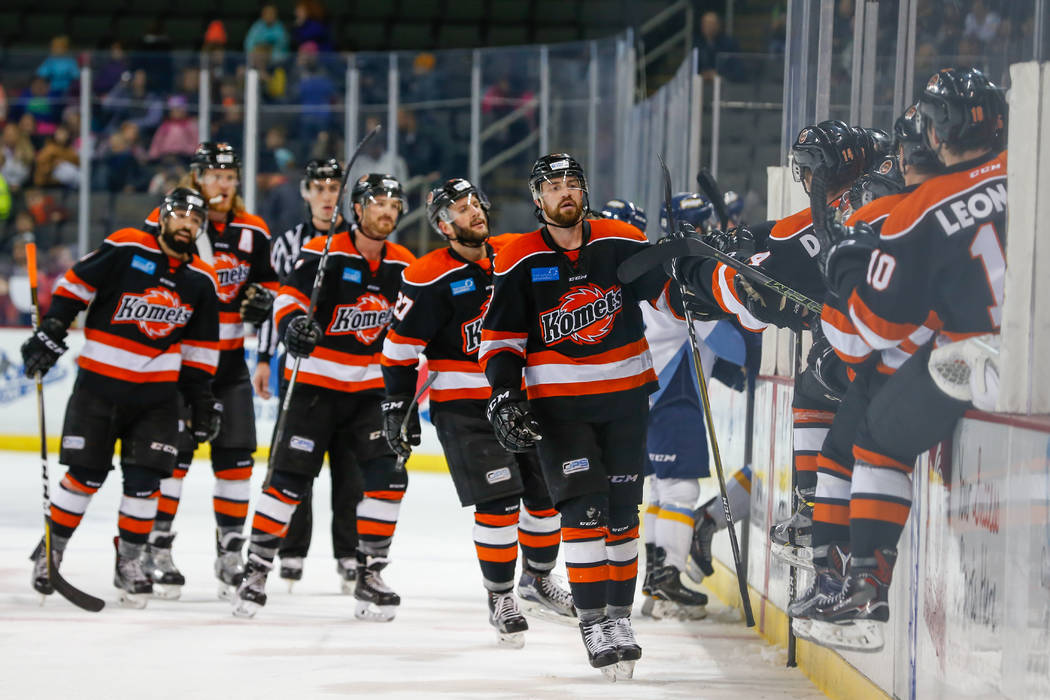 Fort Wayne Komets forward Garrett Thompson (48) receives congratulations from his teammates after scoring a goal during a regular season ECHL hockey game between the Fort Wayne Komets and the Tole ...