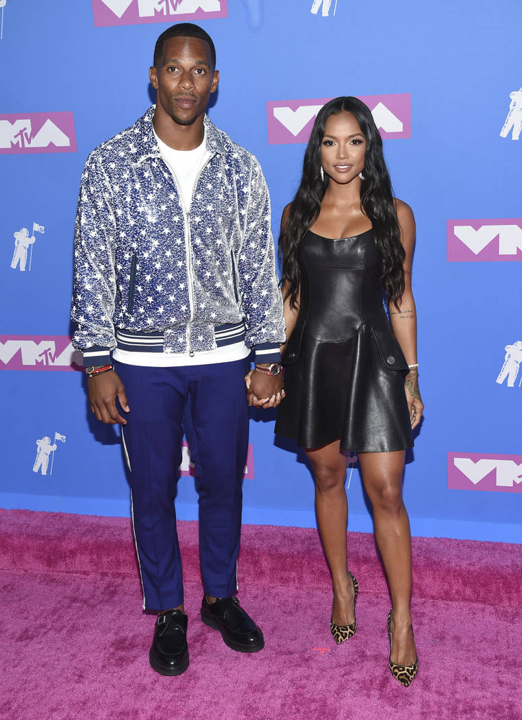 Victor Cruz, left, and Karrueche Tran arrive at the MTV Video Music Awards at Radio City Music Hall on Monday, Aug. 20, 2018, in New York. (Photo by Evan Agostini/Invision/AP)