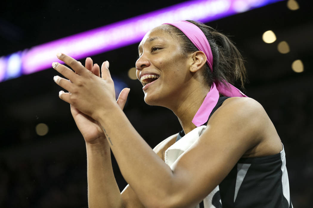Las Vegas Aces center A'ja Wilson (22) reacts to a play by Aces guard Moriah Jefferson (4) during the first half of a WNBA basketball game against the Indiana Fever at the Mandalay Bay Events Cent ...