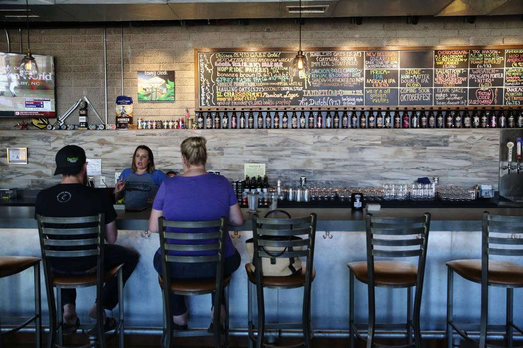 Bar manager Katy Bozoian talks to customers at Tenaya Creek Brewery in Las Vegas, Tuesday, Aug. 21, 2018. Erik Verduzco Las Vegas Review-Journal @Erik_Verduzco