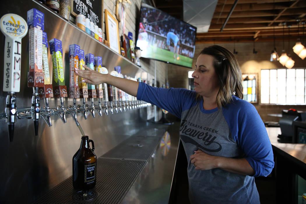 A beer growler is filled by bar manager Katy Bozoian at Tenaya Creek Brewery in Las Vegas, Tuesday, Aug. 21, 2018. Erik Verduzco Las Vegas Review-Journal @Erik_Verduzco