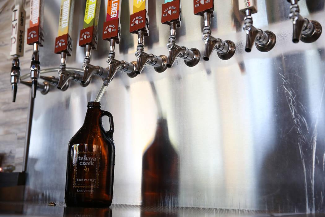 A beer growler is filled at Tenaya Creek Brewery in Las Vegas, Tuesday, Aug. 21, 2018. Erik Verduzco Las Vegas Review-Journal @Erik_Verduzco