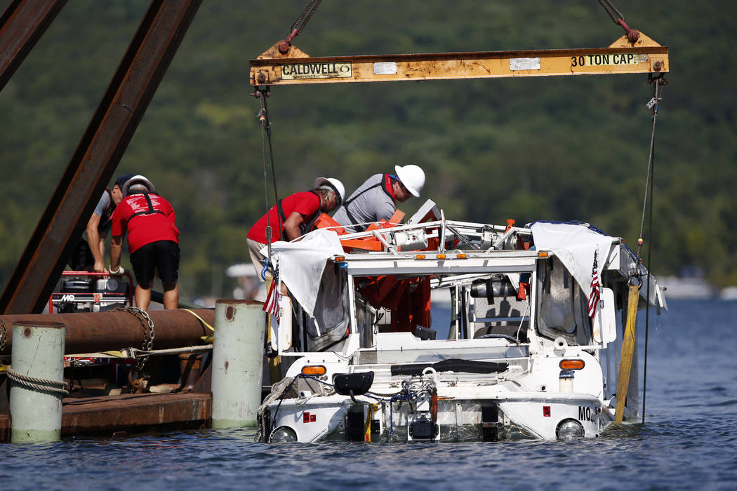 The duck boat that sank in Table Rock Lake in Branson, Mo., is raised Monday, July 23, 2018. The boat went down Thursday evening after a thunderstorm generated near-hurricane strength winds. (Nath ...