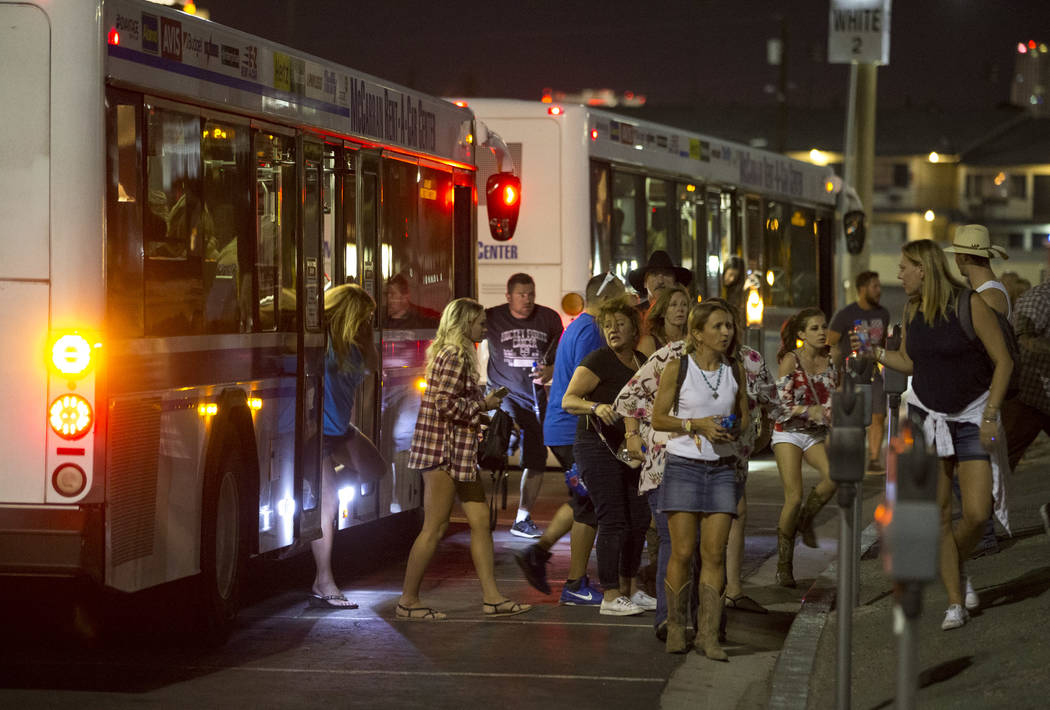 Festival-goers attending the Route 91 Harvest Festival were evacuated by bus to Thomas and Mack Arena early Monday, Oct. 2, 2017, following a shooting situation on the Las Vegas Strip. Richard Bri ...