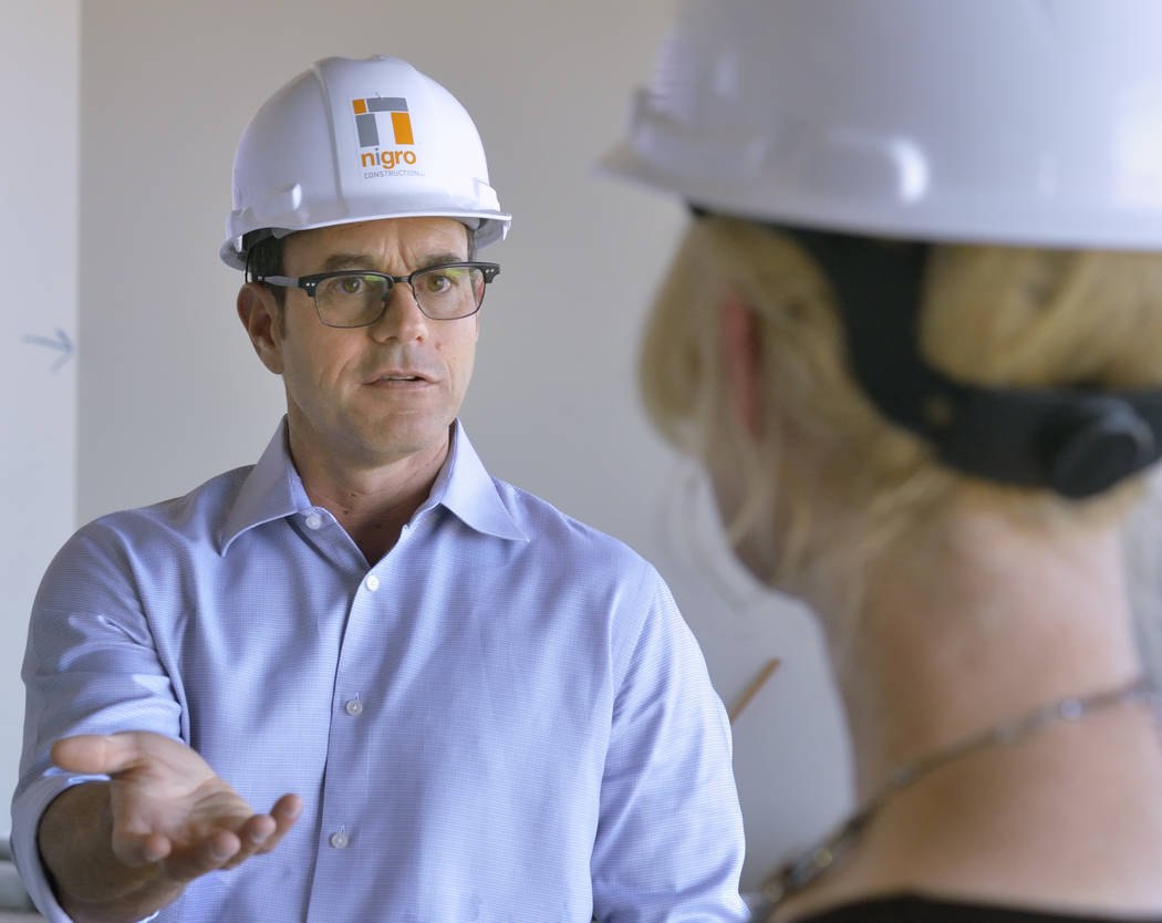 Mike Nigro, president of Nigro Construction, left, talks with Melissa War, CEO of Mountain's Edge Hospital, during a tour of the expansion to the hospital's orthopedic surgery center ...