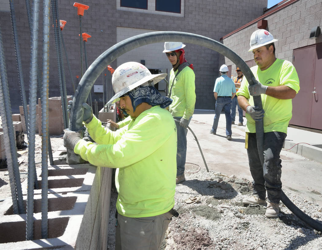 Bill Hughes RJRealEstate.Vegas Workers pour concrete for a wall which is part of the expansion to the Mountain's Edge Hospital Orthopedic Surgery Center.