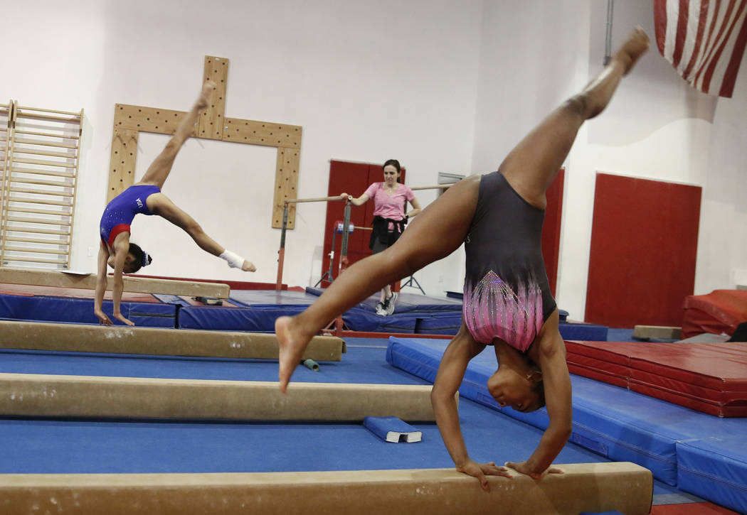 Gymnasts Kailin Chio, 12, left, and Selena Harris, 14, practice on the balance beam at Gymcats Gymnastics Center on Monday, Aug. 13, 2018, in Henderson. Bizuayehu Tesfaye/Las Vegas Review-Journal ...