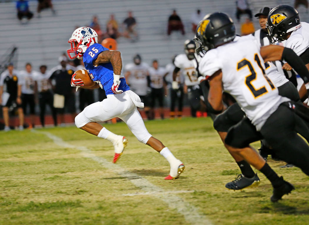 Liberty's running back Kishon Pitts (25) runs into the end zone for a touchdown as Saguaro's Brandon Shivers (21) chases him during the second quarter of a football game at Liberty High School in ...