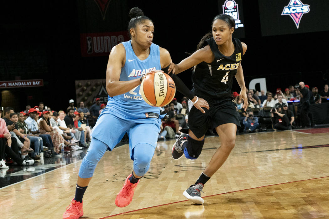 Las Vegas Aces guard Moriah Jefferson (5) tries to defend Atlanta Dream guard Alex Bentley (20) during the second half of a WNBA basketball game at the Mandalay Bay Events Center in Las Vegas, Sun ...