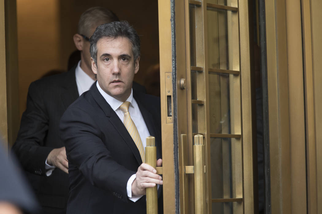 Michael Cohen leaves federal court, Tuesday, Aug. 21, 2018, in New York. Cohen, has pleaded guilty to charges including campaign finance fraud stemming from hush money payments to porn actress Sto ...