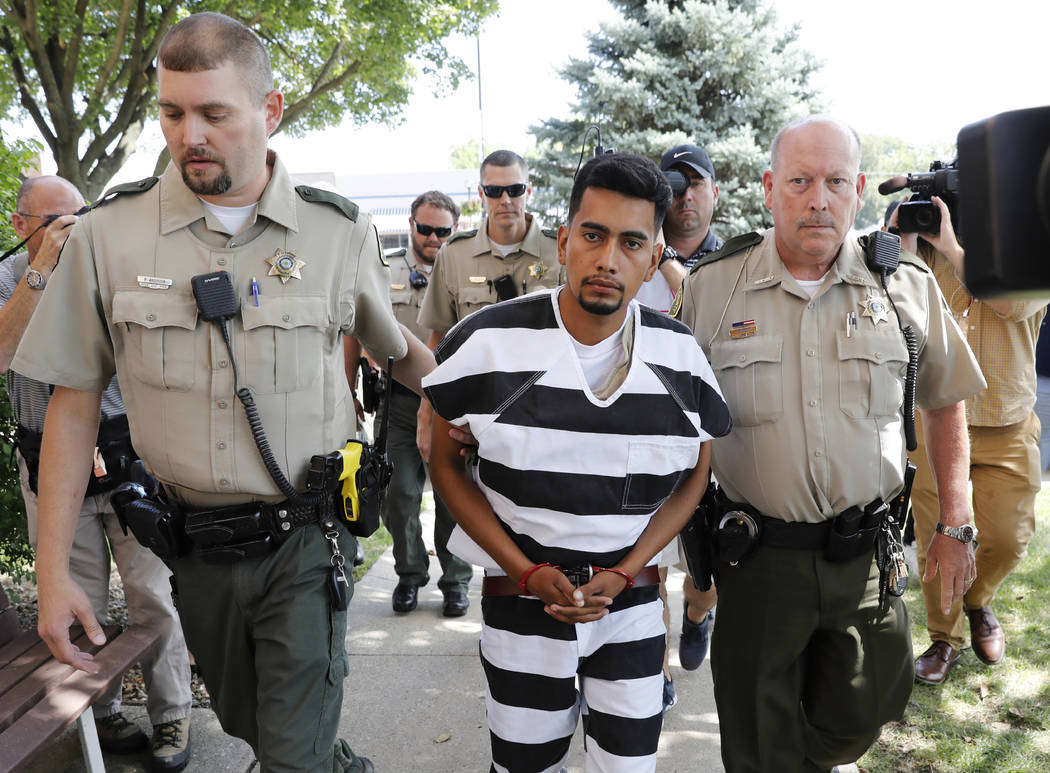 Cristhian Bahena Rivera is escorted into the Poweshiek County Courthouse for his initial court appearance, Wednesday, Aug. 22, 2018, in Montezuma, Iowa. Rivera is charged with first-degree murder ...