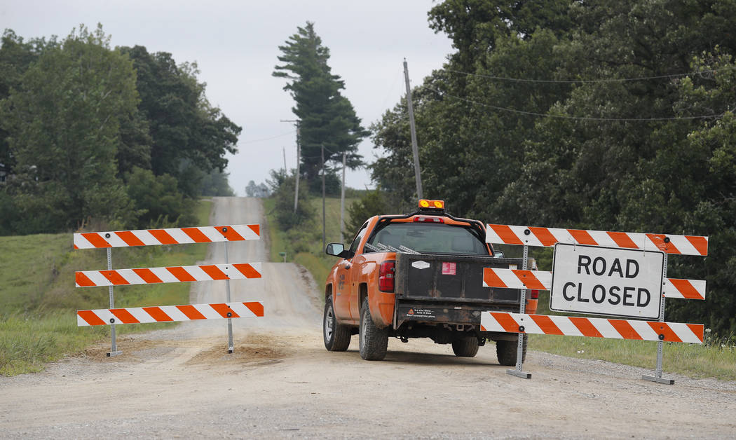 A county truck blocks a gravel road, Tuesday, Aug. 21, 2018, near Brooklyn, Iowa. Police say a body believed to be that of 20-year-old college student Mollie Tibbetts has been discovered in a rura ...