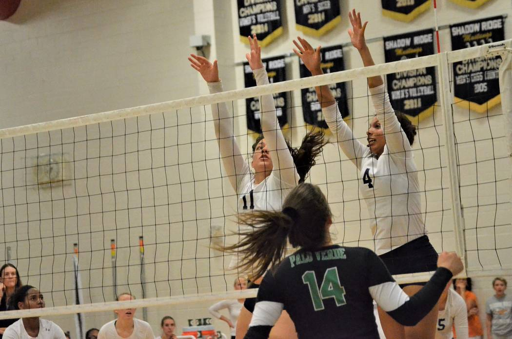 Shadow Ridge's Natalie Nihipali (11) and Kizzy Rodriguez (4) sky for a block, as Palo Verde's Liz Gutierrez watches, during Tuesday's girls' volleyball match at Shadow Ridge. (Courtesy Shadow Ridg ...