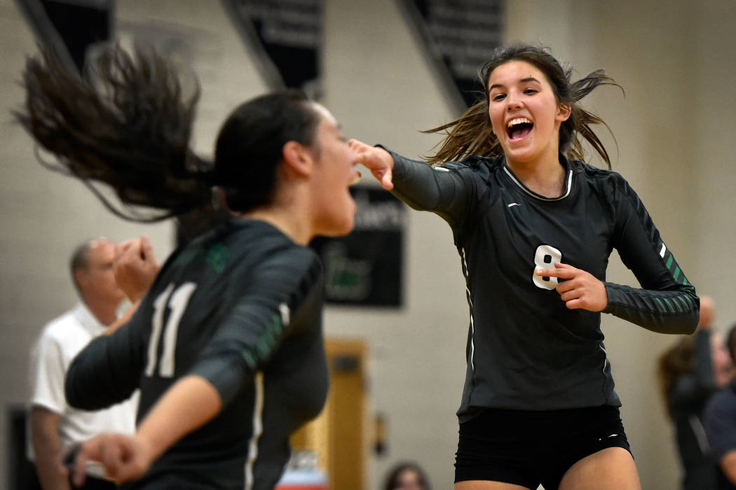 Palo Verde's Arien Fafard (11) and Carli Tanner celebrate a point against Faith Lutheran during a high school volleyball game at Palo Verde High School Tuesday, Sept. 27, 2016, in Las Vegas. Palo ...