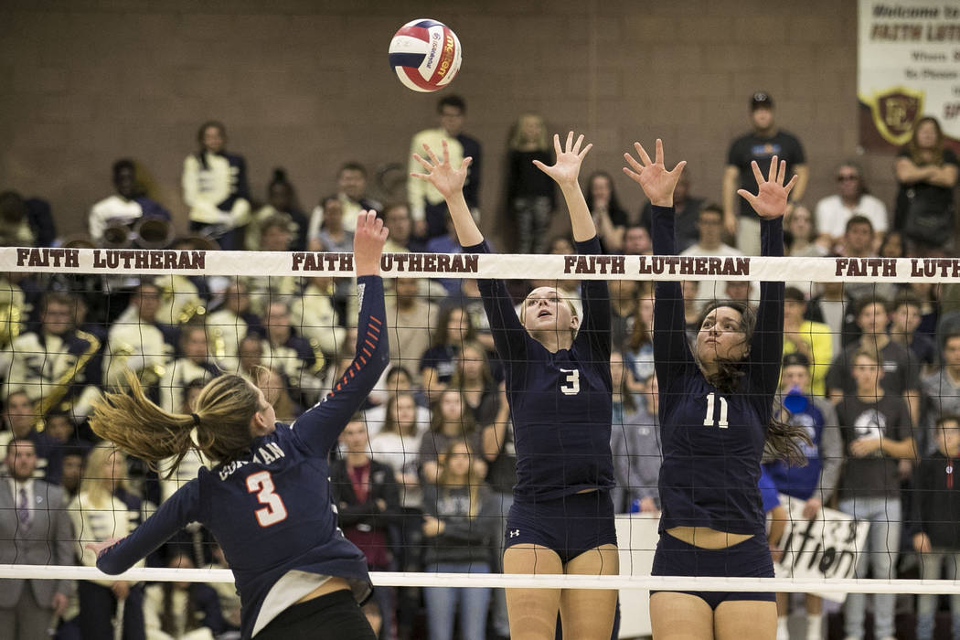 Gorman's Tommi Stockham (3) tips the ball over Shadow Ridge's Madison Norr (3) and Kahea Nihipali (11) during the Class 4A state volleyball championship game at Faith Lutheran High School in Las V ...