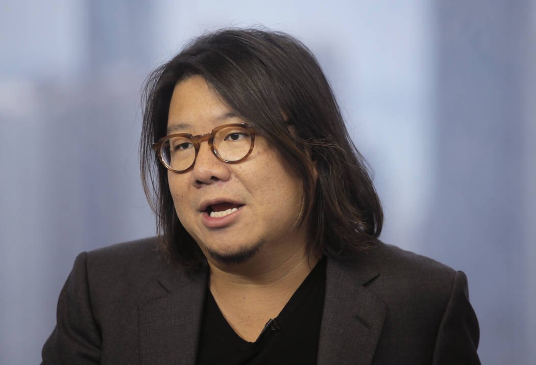 Singaporean novelist Kevin Kwan talks during an interview in Hong Kong on Friday, Aug. 25, 2017. (AP Photo/Vincent Yu, File)