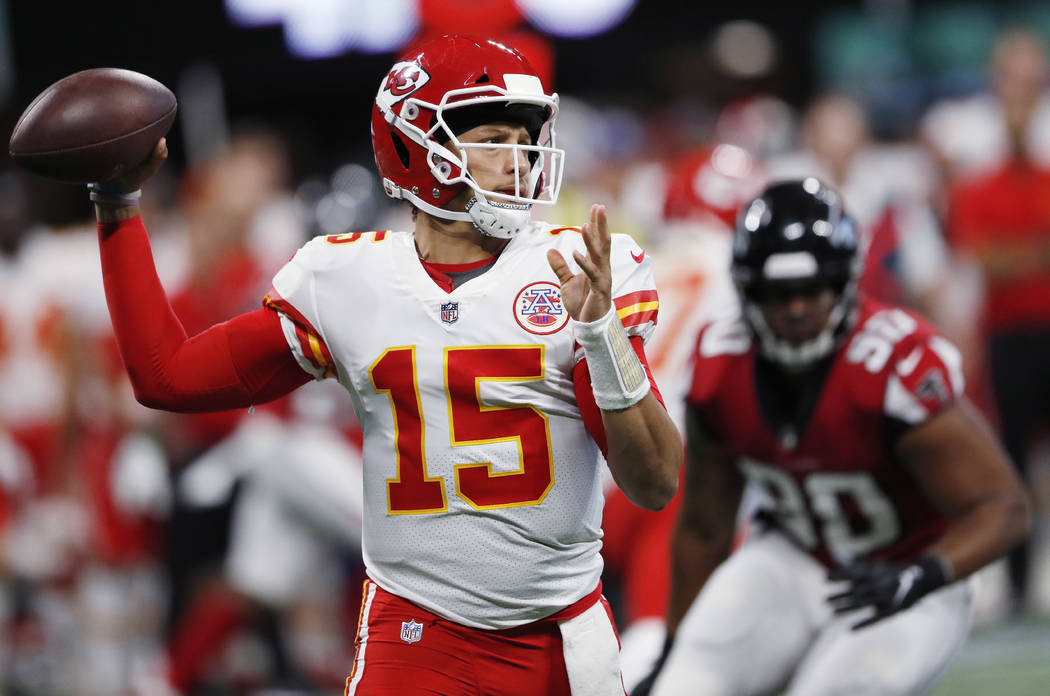 Kansas City Chiefs quarterback Patrick Mahomes (15) passes against the Atlanta Falcons during the first half of an NFL preseason football game, Friday, Aug. 17, 2018, in Atlanta. (AP Photo/John Ba ...