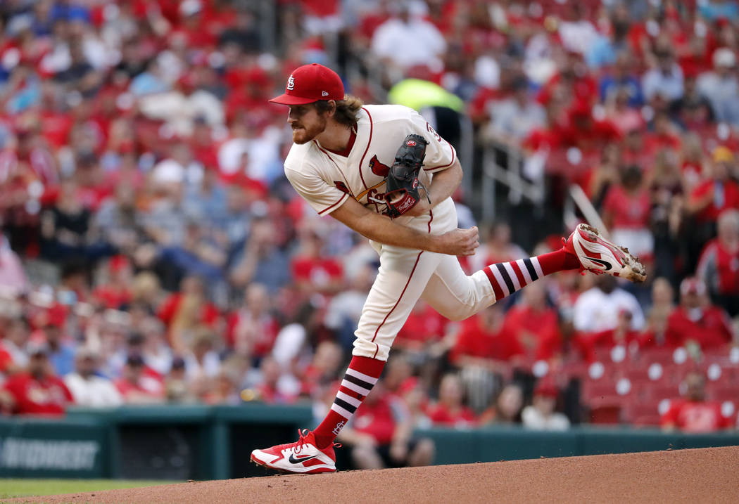 St. Louis Cardinals starting pitcher Miles Mikolas throws during the first inning of a baseball game against the Milwaukee Brewers Saturday, Aug. 18, 2018, in St. Louis. (AP Photo/Jeff Roberson)