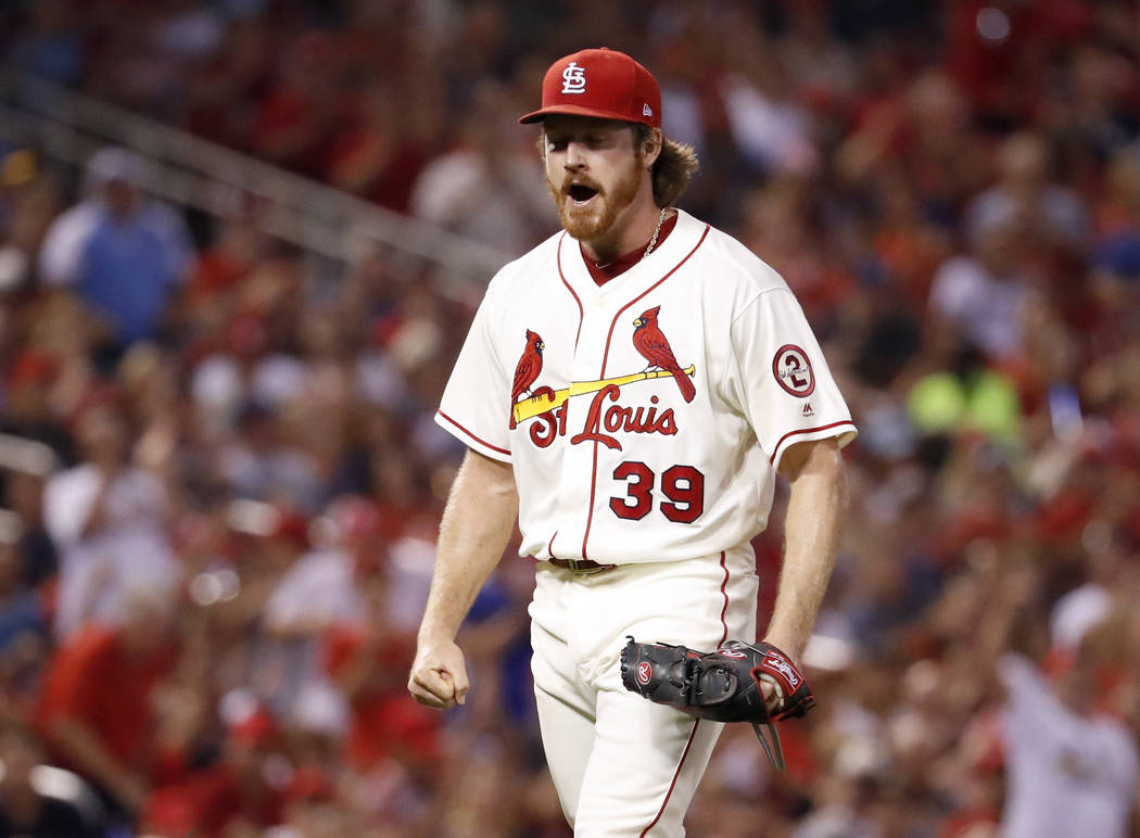 St. Louis Cardinals starting pitcher Miles Mikolas celebrates after striking out Milwaukee Brewers' Eric Thames to end the top of the sixth inning of a baseball game Saturday, Aug. 18, 2018, in St ...