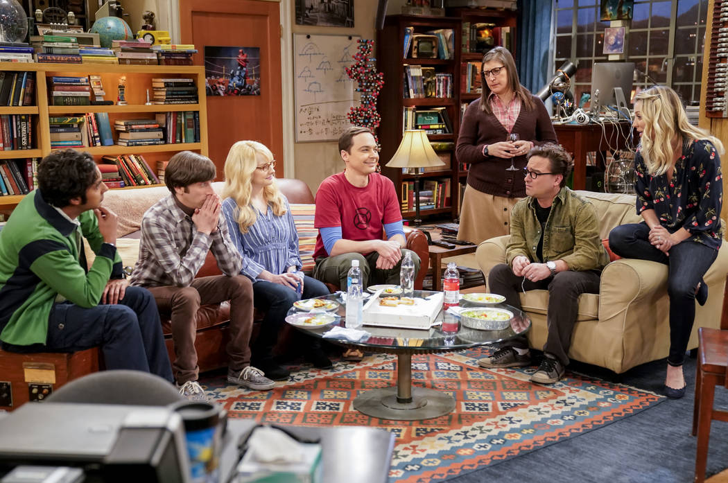This image released by CBS shows Kunal Nayyar, from left, Simon Helberg, Melissa Rauch, Jim Parsons, Mayim Bialik, Johnny Galecki and Kaley Cuoco appear in a scene from the long-running comedy se ...