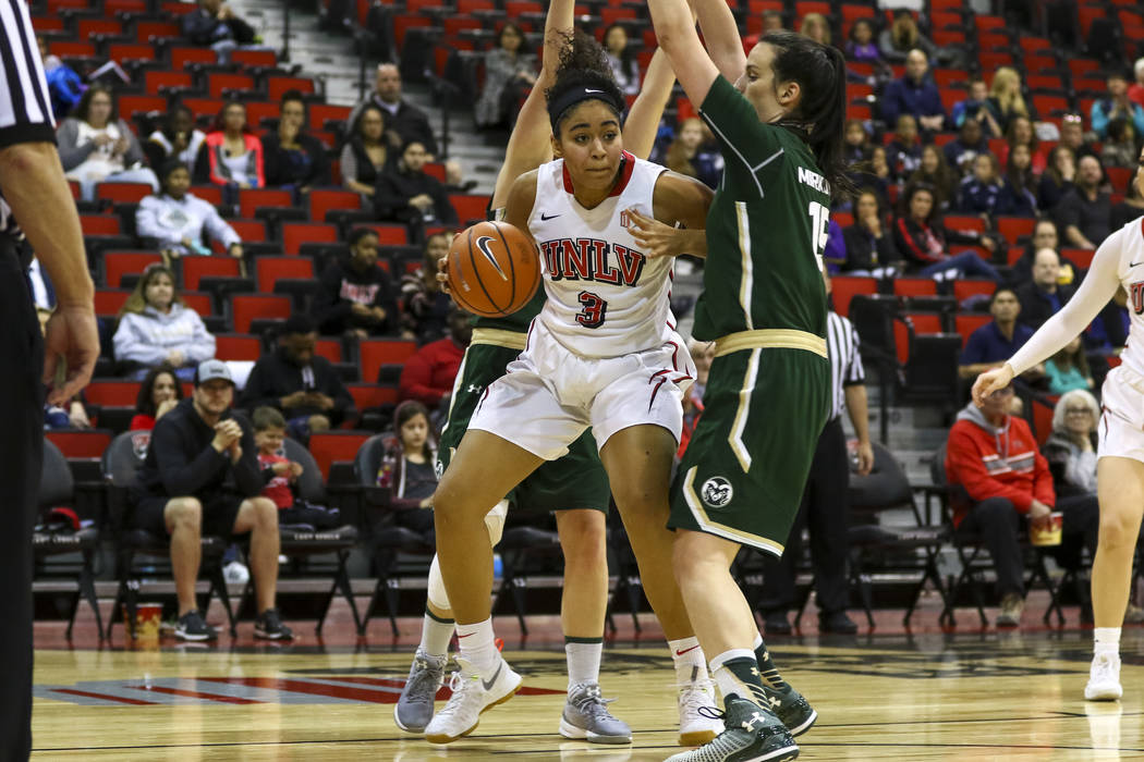 UNLV Rebels forward/center Paris Strawther (3) dribbles the ball against Colorado State Rams forward Veronika Mirkovic (15) during a college basketball game at Cox Pavilion in Las Vegas on Saturda ...
