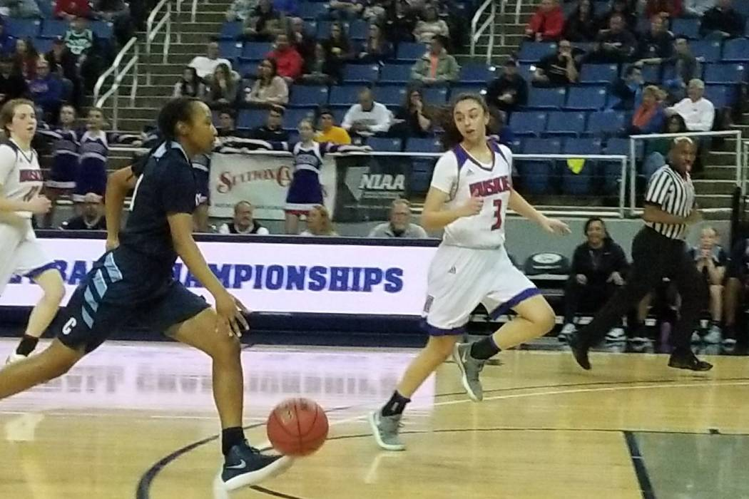 Centennial's Justice Ethridge drives to the basket against Reno's Hana Hackbush (3) on Thursday, Feb. 22, 2018 at Lawlor Events Center in Reno. Centennial beat Reno High 68-30 in the Class 4A stat ...