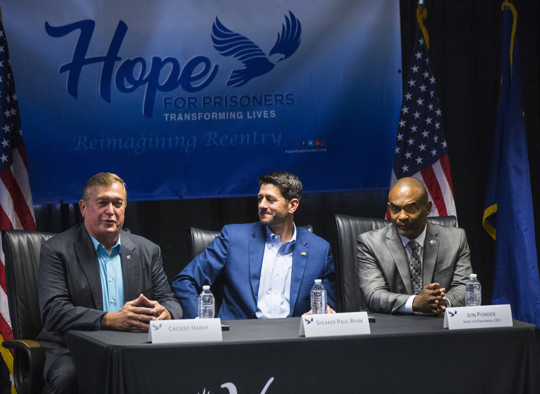 Former U.S. Rep. Cresent Hardy, left, speaks as House Speaker Paul Ryan, R-Wis., center, and Hope for Prisoners CEO Jon Ponder look on during a roundtable discussion at Hope for Prisoners in Las V ...