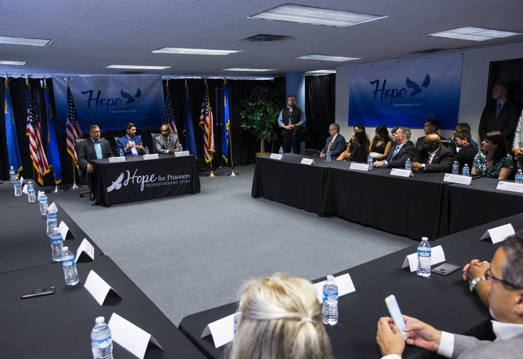House Speaker Paul Ryan, R-Wis., center left, speaks as former U.S. Rep. Cresent Hardy, left, and Hope for Prisoners CEO Jon Ponder look on during a roundtable discussion at Hope for Prisoners in ...