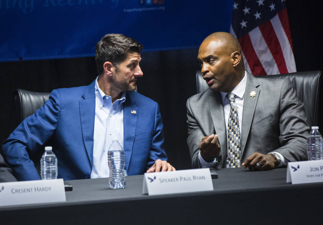 House Speaker Paul Ryan, R-Wis., left, listens to Hope for Prisoners CEO Jon Ponder during a roundtable discussion at Hope for Prisoners in Las Vegas on Wednesday, Aug. 22, 2018. Chase Stevens Las ...