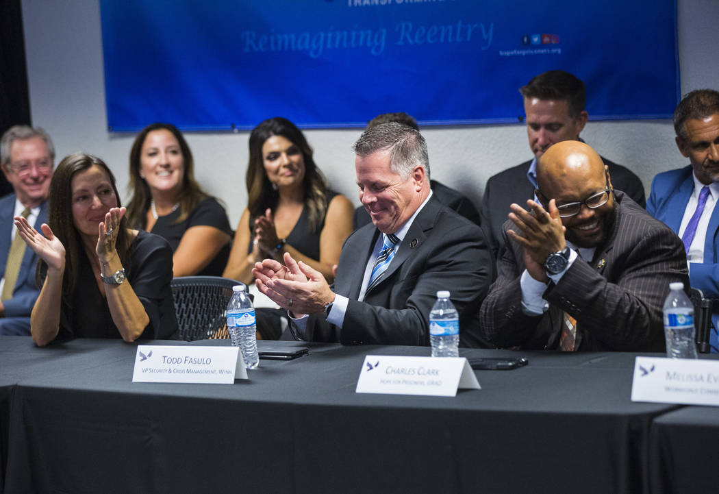 Lindy Schumacher, CEO of Fulfillment Fund Las Vegas, from left, Todd Fasulo, vice president of security and crisis management for Wynn Resorts, and Hope for Prisoners program graduate Charles Clar ...