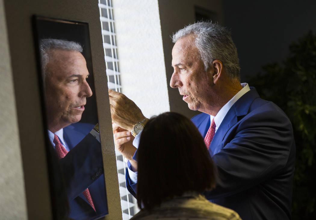 Clark County District Attorney Steve Wolfson is reflected in a frame before the start of a roundtable discussion at Hope for Prisoners in Las Vegas on Wednesday, Aug. 22, 2018. Chase Stevens Las V ...