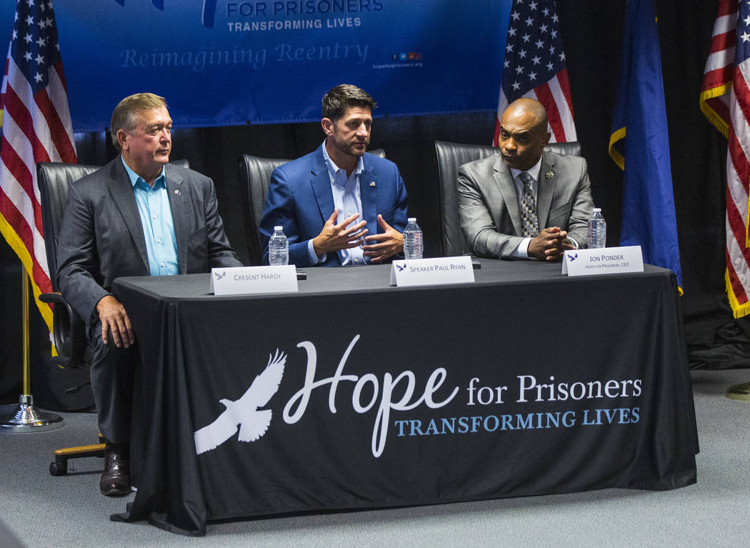House Speaker Paul Ryan, R-Wis., center, speaks as former U.S. Rep. Cresent Hardy, left, and Hope for Prisoners CEO Jon Ponder look on during a roundtable discussion at Hope for Prisoners in Las V ...