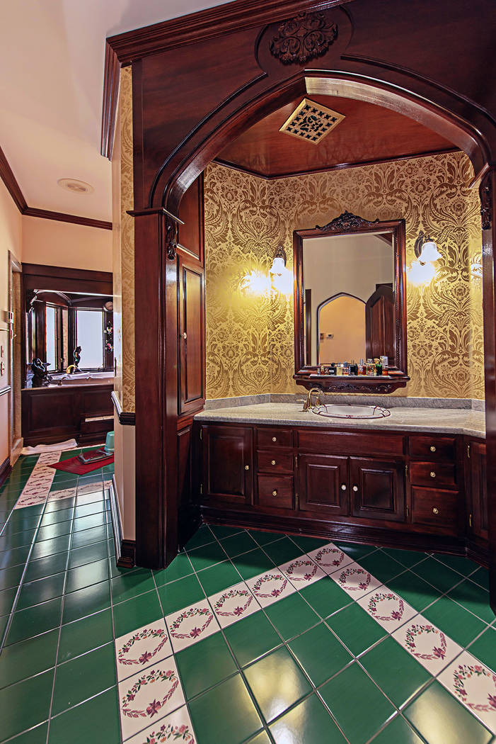 The master bath features a double vanity, jacuzzi tub and separate shower. (Rob Jensen Co.)