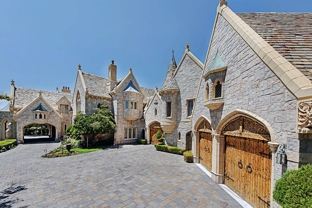 The castle has a striking stone porte-cochere. (Rob Jensen Co.)