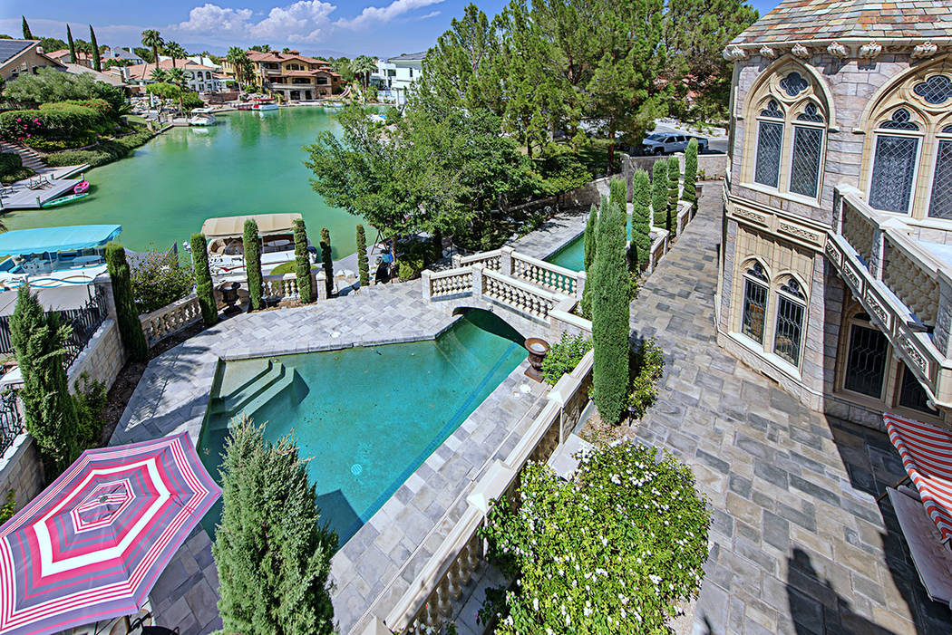 The 11,662-square-foot castle is on The Lakes and has a boat dock. (Rob Jensen Co.)
