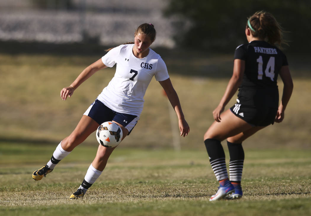 Centennial's Marcella Brooks (7) kicks the ball against Palo Verde's Reighna Werner (14) during a soccer game at Centennial High School in Las Vegas on Tuesday, Sept. 19, 2017. Chase Stevens Las V ...