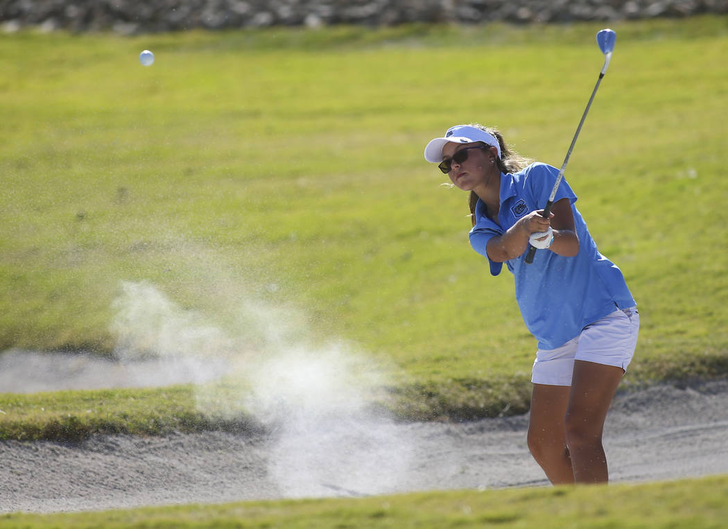 Centennial's McKenzi Hall hits out of the bunker during the Class 4A state girls golf tournament at Highland Falls golf course in Las Vegas on Tuesday, Oct. 17, 2017. Chase Stevens Las Vegas Revie ...