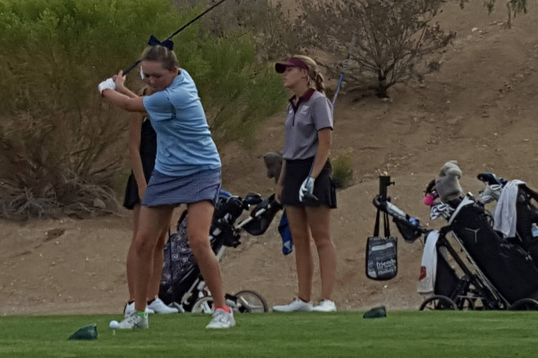 Hailey Stevenson of Centennial prepares to hit a drive at last year's Class 4A regional girls golf tournament. She and her teammates are back for this year's regional tournament that begins Monday ...