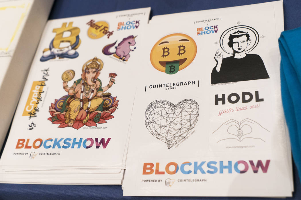 Stickers at the CoinTelegraph booth at Block Show at The Venetian in Las Vegas, Tuesday, Aug. 21, 2018. (Marcus Villagran/Las Vegas Review-Journal) @brokejournalist