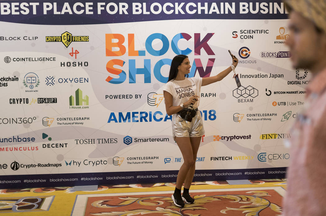 Maria Jones, vice president of CoinTelegraph, takes a selfie at Block Show at The Venetian in Las Vegas, Tuesday, Aug. 21, 2018. (Marcus Villagran/Las Vegas Review-Journal) @brokejournalist