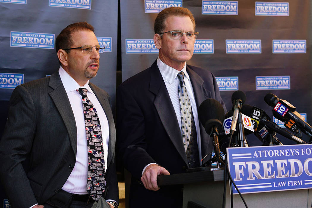 Douglas Haig, right, speaks at a news conference with his attorney, Marc J. Victor, center, on Feb. 2, 2018, in Chandler, Ariz. (Las Vegas Review-Journal)