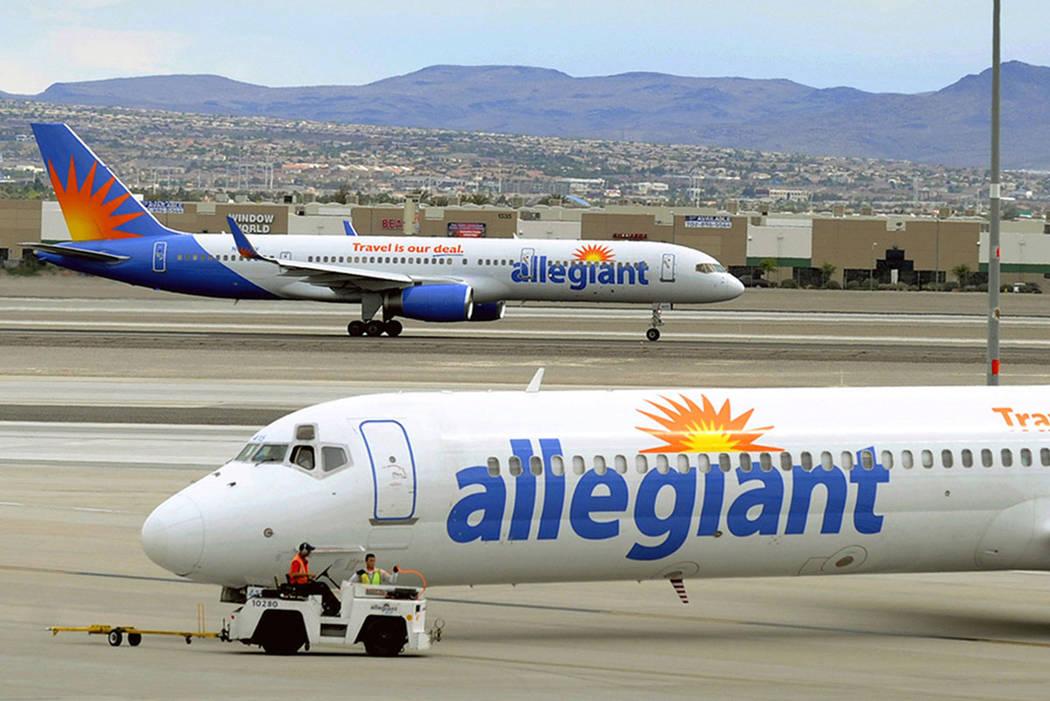 Allegiant Air Jets Taxi At Mccarran International Airport In Las Vegas The Associated Press