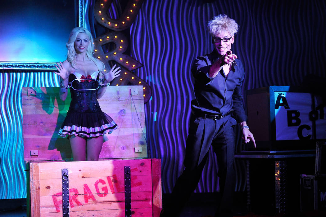 Magician and comedian Murray SawChuck (cq), right, performs with his wife and assistant Chloe Crawford during an afternoon show at the Planet Hollywood hotel-casino on Tuesday, Dec. 30, 2014, in L ...