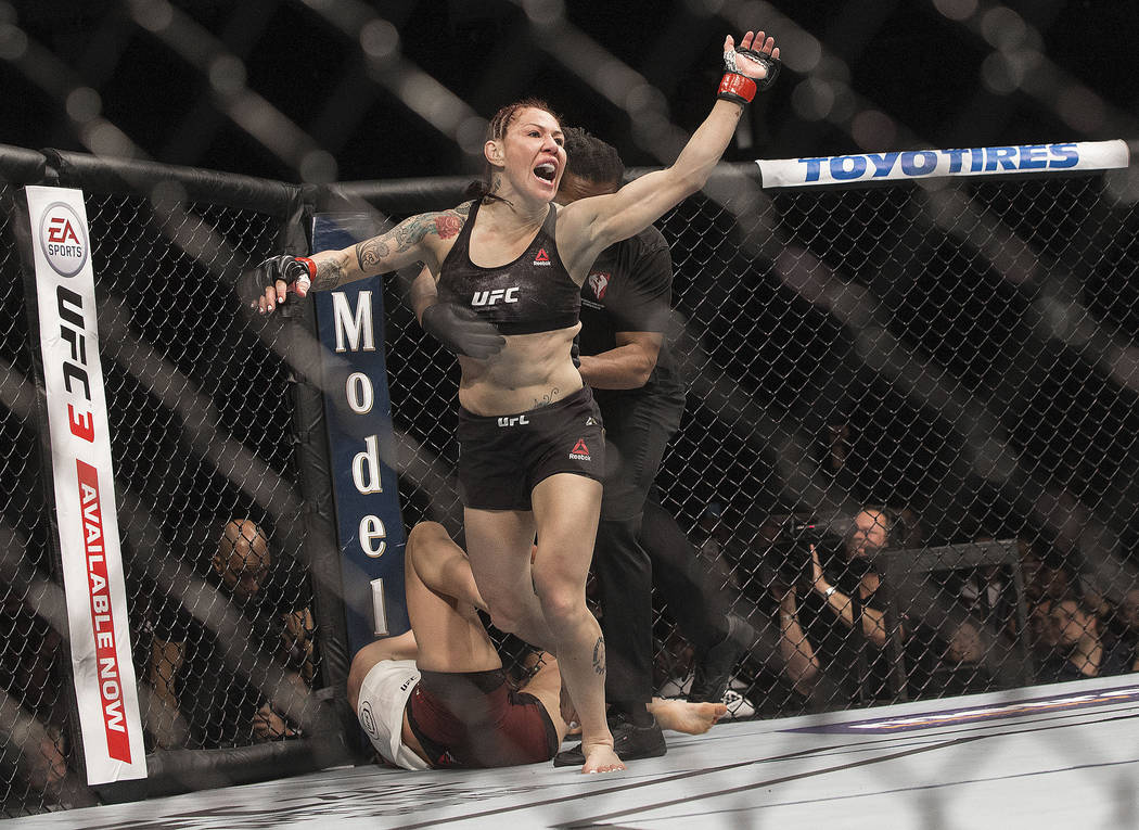 "Cris ""Cyborg"" Justino celebrates after defending her featherweight title against Yana Kunitskaya, in the first round of a mixed martial arts bout at UFC 222 on Saturday, March 3, 2018, i ..."