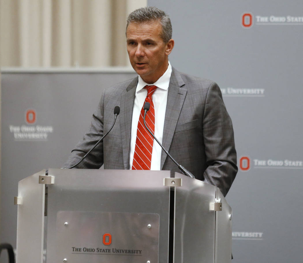 Ohio State football coach Urban Meyer makes a statement during a news conference in Columbus, Ohio, Wednesday, Aug. 22, 2018. Ohio State suspended Meyer on Wednesday for three games for mishandlin ...