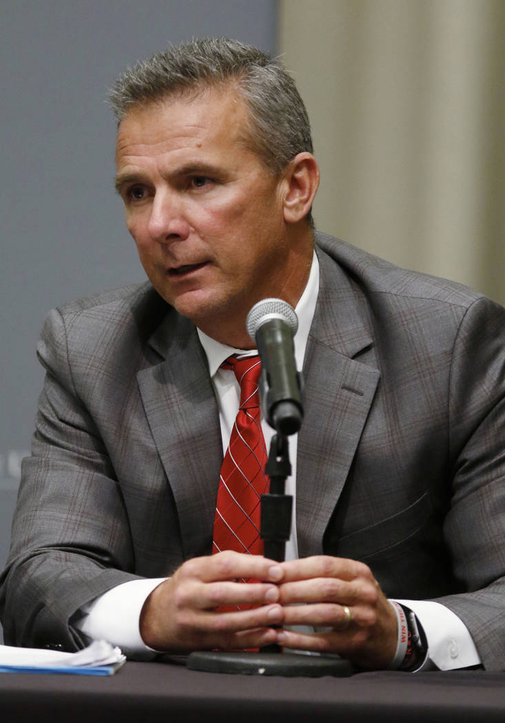 Ohio State football coach Urban Meyer answers questions during a news conference in Columbus, Ohio, Wednesday, Aug. 22, 2018. Ohio State suspended Meyer on Wednesday for three games for mishandlin ...