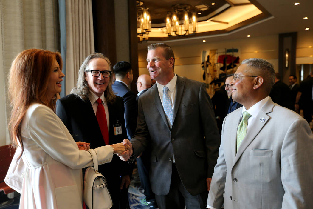 Brad Friedmutter, of Friedmutter Group, architect for the new MGM Springfield, second from left, and his wife Kimberly visit with Massachusetts state representatives Jose Tosado, right, and Mike F ...