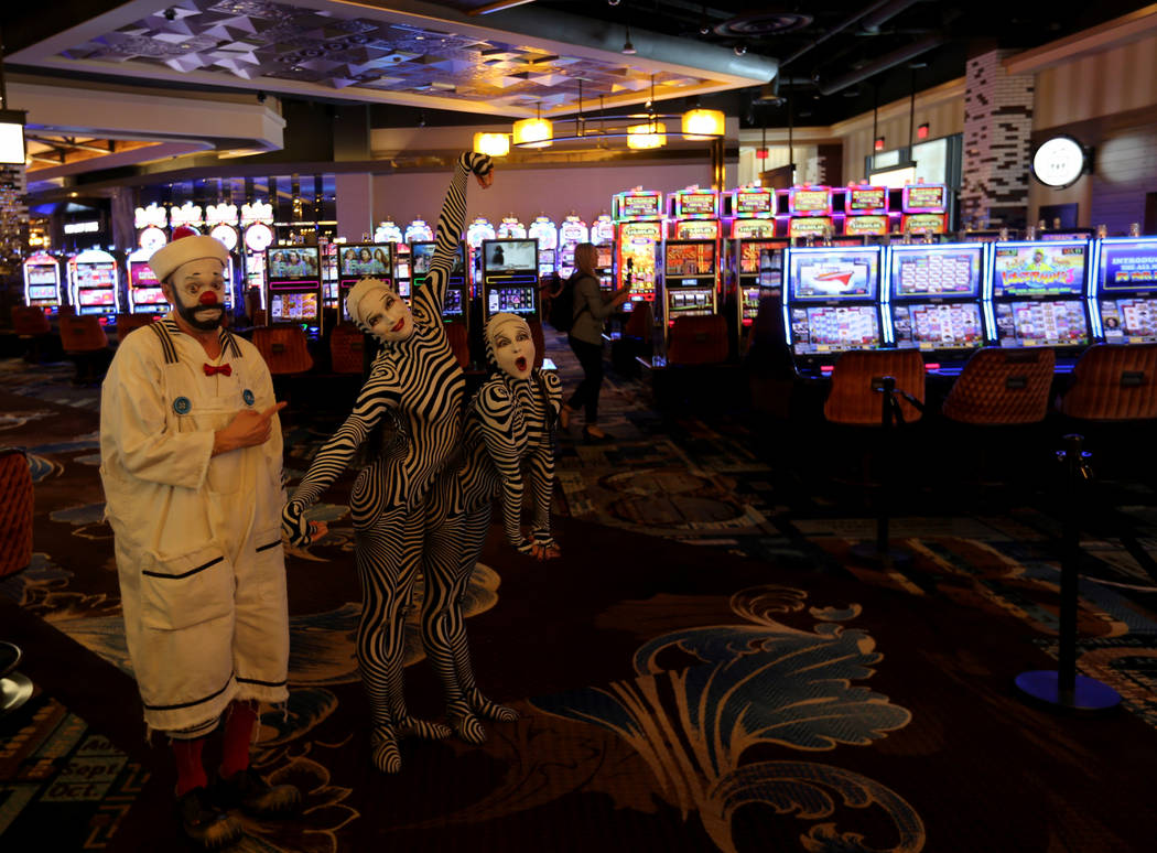 Characters from the Cirque du Soleil show ÒOÓ greet guests on casino floor at the new MGM Springfield $960 million casino in Massachusetts during media day Thursday, Aug. 23, 2018. The c ...