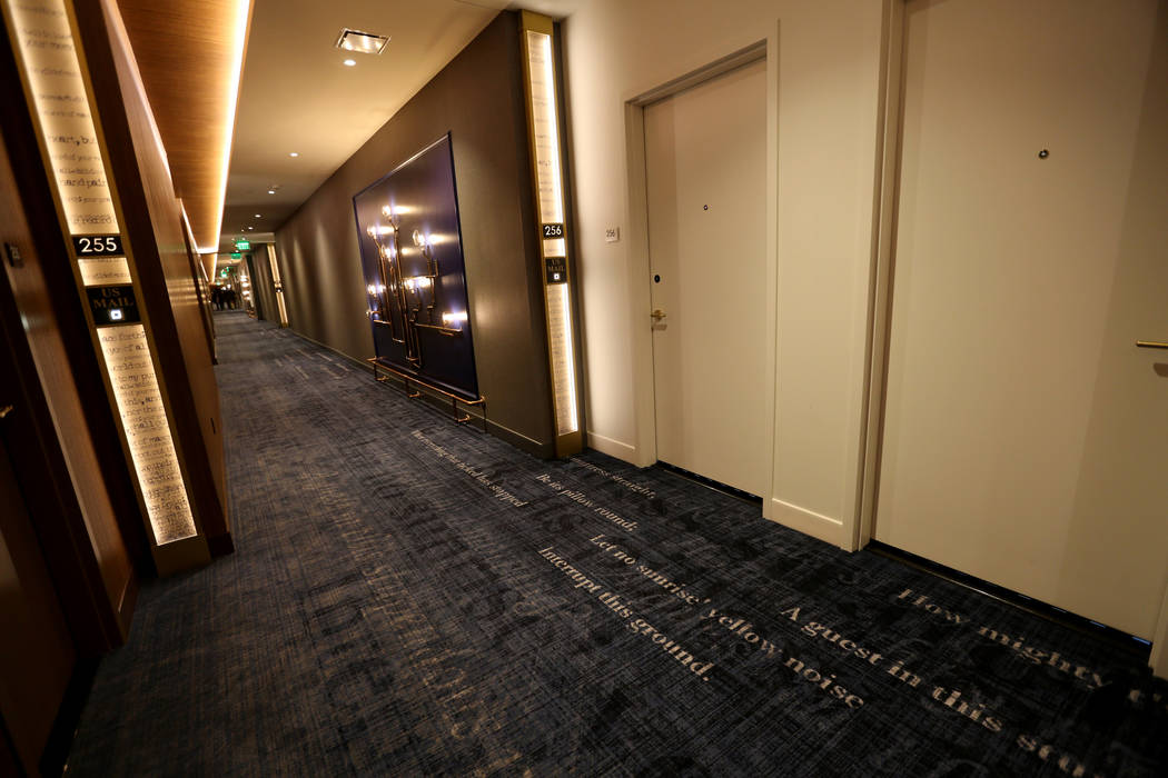 Words on the carpet from the writings of Emily Dickinson at the new MGM Springfield $960 million casino in Massachusetts during a media tour Thursday, Aug. 23, 2018. The casino opens Friday. K.M. ...